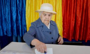 A Romanian woman casts her ballot for the European Parliament elections near booths featuring the national colors of Romania at a polling station in Bucharest on May 25, 2014.  AFP PHOTO DANIEL MIHAILESCU        (Photo credit should read DANIEL MIHAILESCU/AFP/Getty Images)